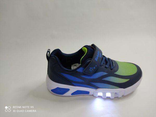 Zapatillas deportivas en color marino. Cordón elástico y velcro. Luces en la suela.